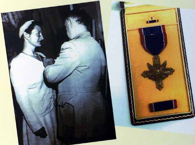 Hall receiving her medal from General William Joseph Donovan.